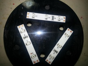 Self adhesive LED strips adhered to the base. Edges lined up with marks on 3D part.